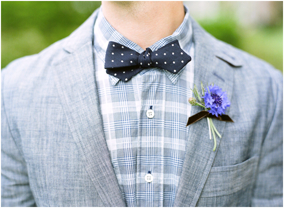 Casual dapper groom wears plaid shirt, grey morning suit, blue bowtie
