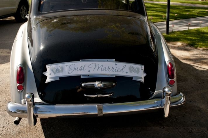Vintage Rolls Royce wedding day transportation with Just Married