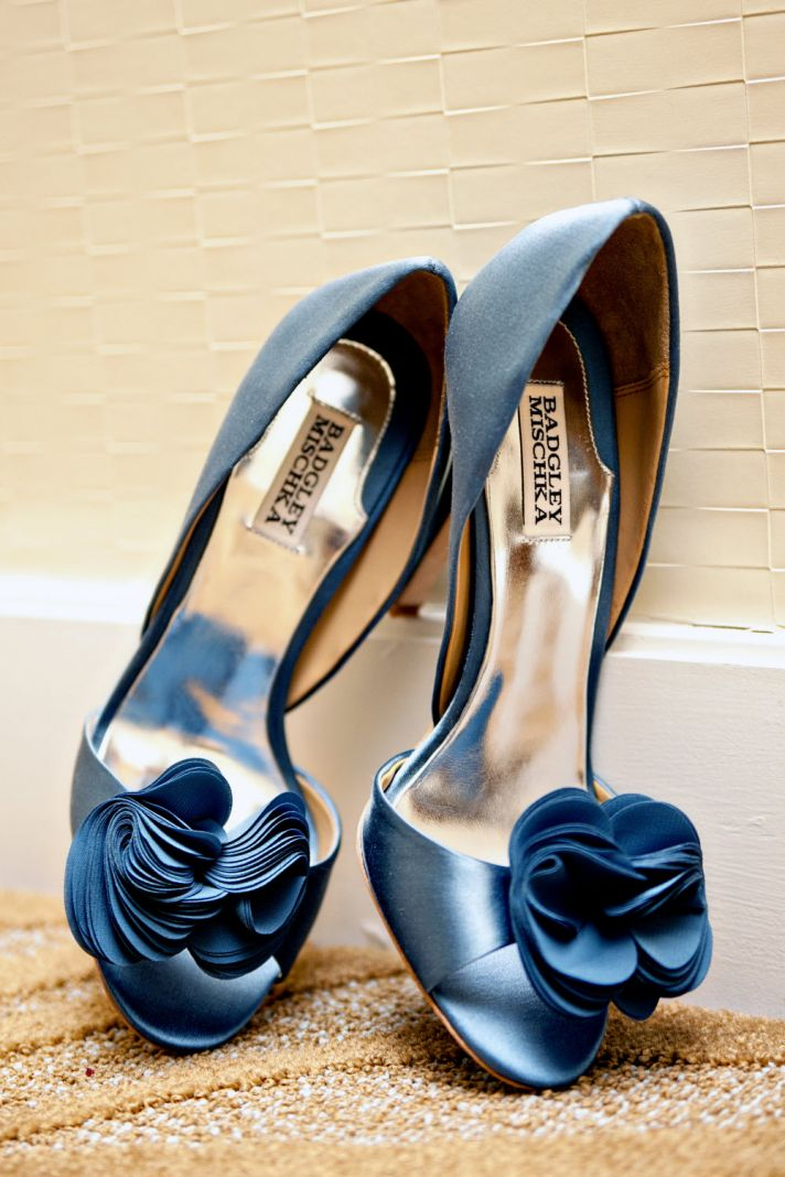 Blue peep-toe Badgely Mischka bridal heels with floral rosette detail