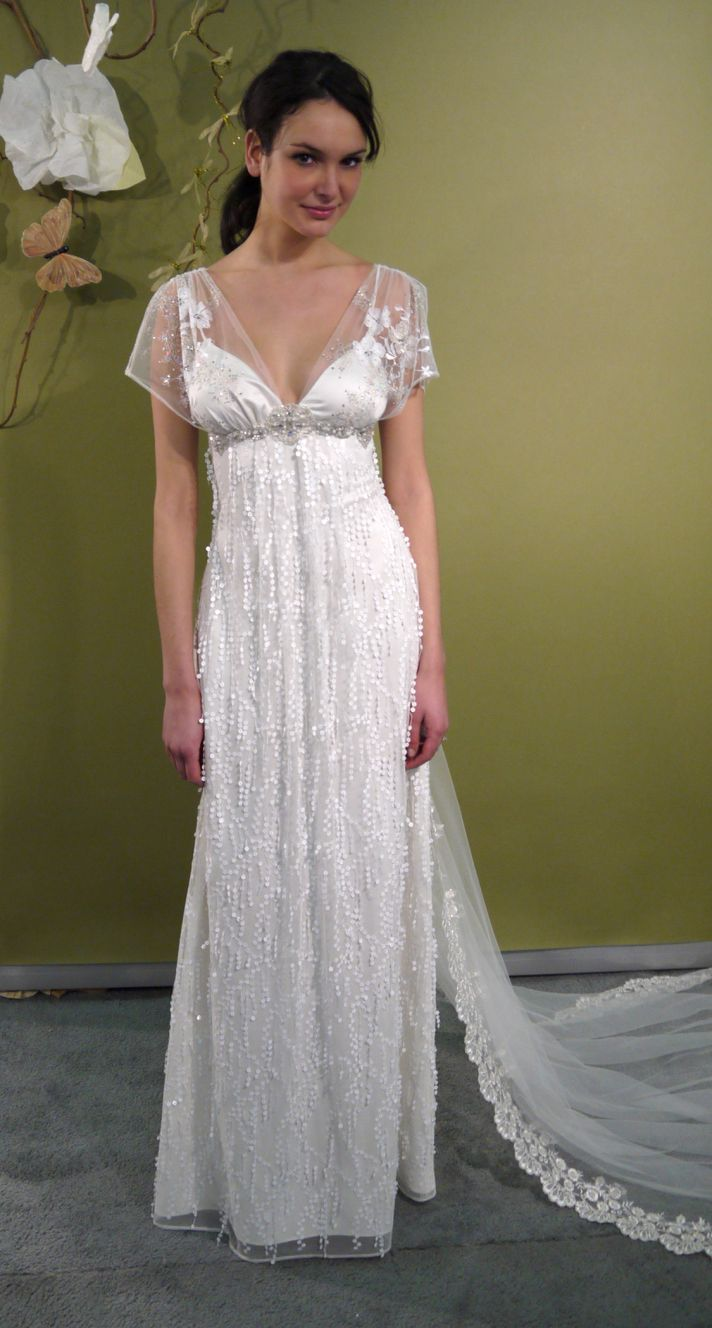 Ivory empire v-neck wedding dress with sheer sleeves and beaded bridal belt by Claire Pettibone
