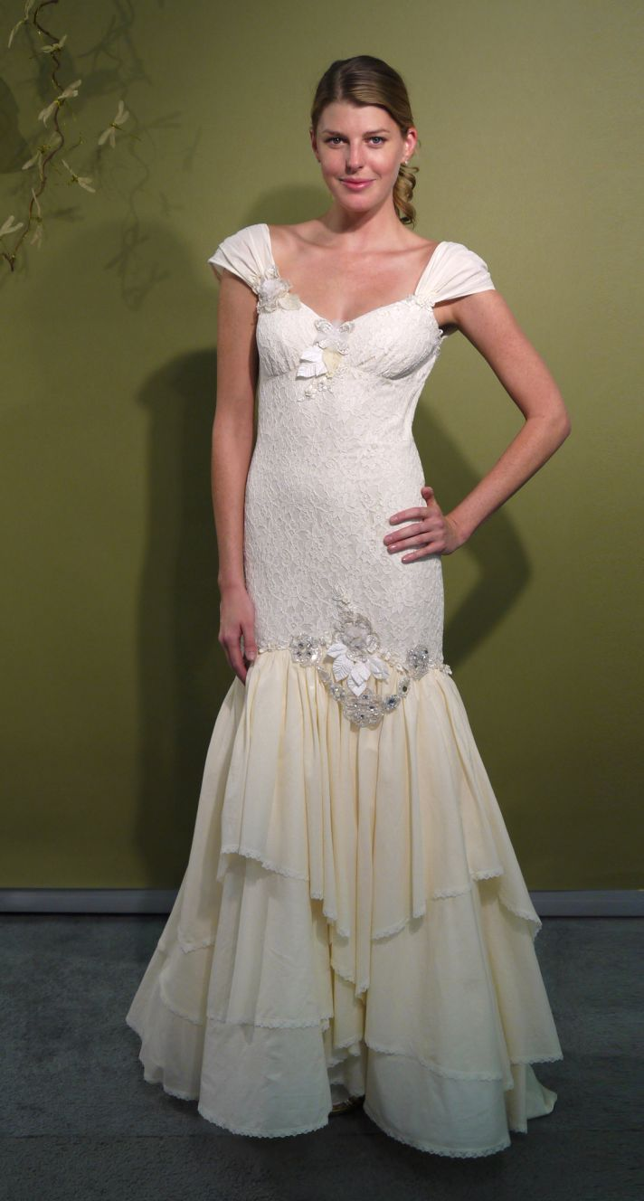 Ivory drop-waist mermaid wedding dress with romantic lace cap sleeves and beading embellishment by C