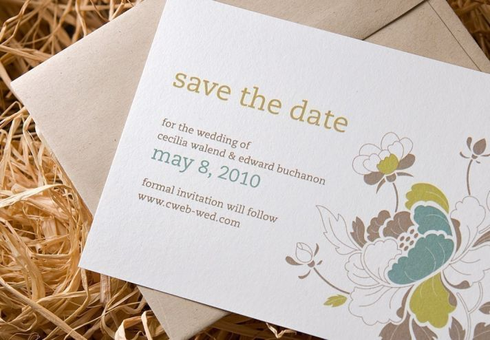 Eco-friendly white letterpress wedding invitations with romantic cityscape design