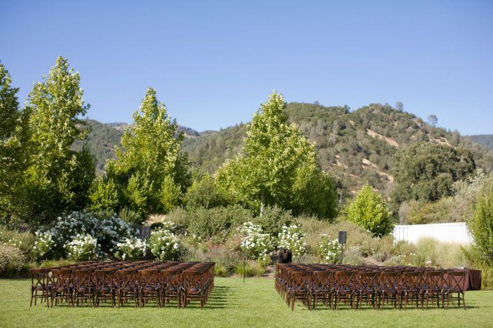 Picturesque outdoor California wedding ceremony at vineyard venue