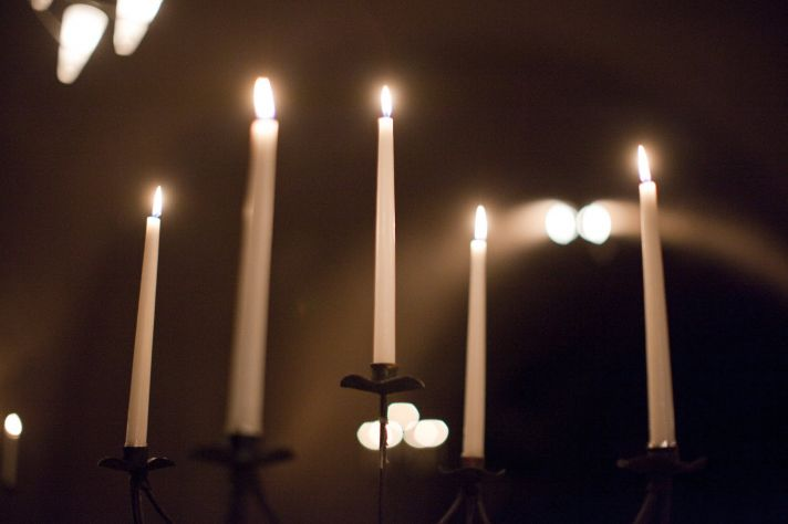 ROmantic stick candles placed in regal candelabras dress up vineyyard wedding venue