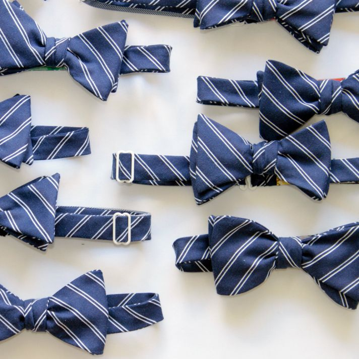 Navy blue and white striped bow ties for groom and groomsmen