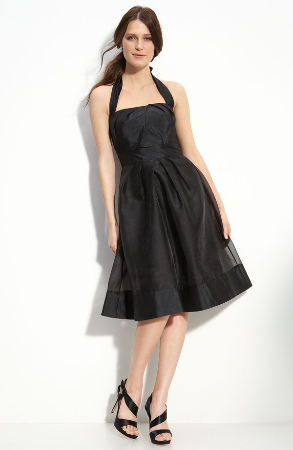 Black halter neckline bridesmaids dress with full knee-length skirt