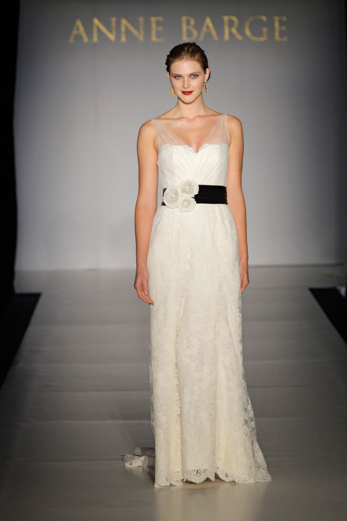 Romantic ivory lace column wedding dress with sheer illusion straps and black bridal belt