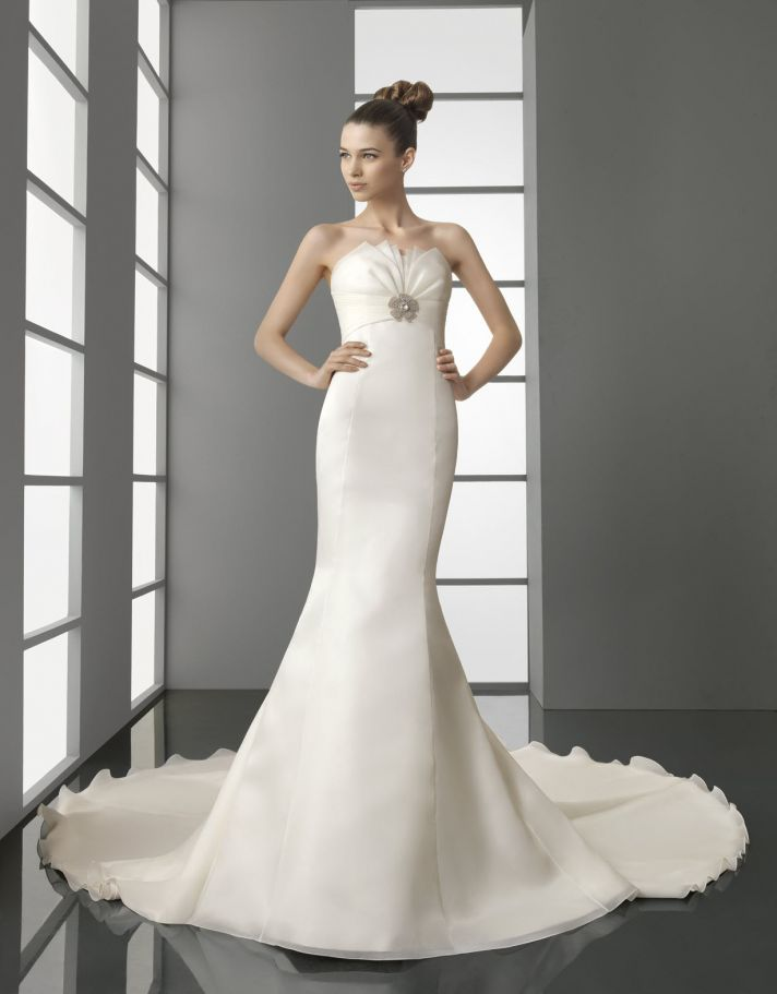Ivory satin mermaid wedding dress with rhinestone brooch below bust and lace detail on train