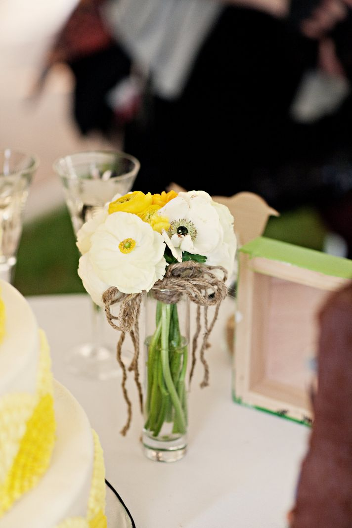Gorgeous white and yellow Spring bridal bouquet placed in vintage mason jar