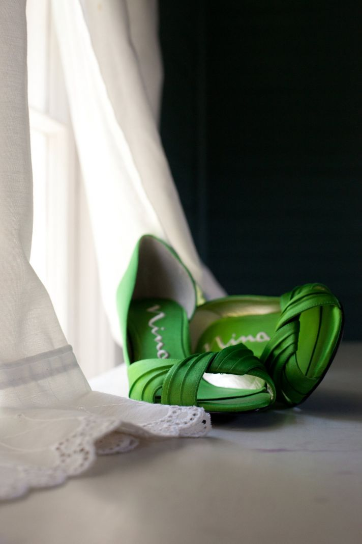 Chic green satin peeptoe bridal heels and ivory lace wedding dress