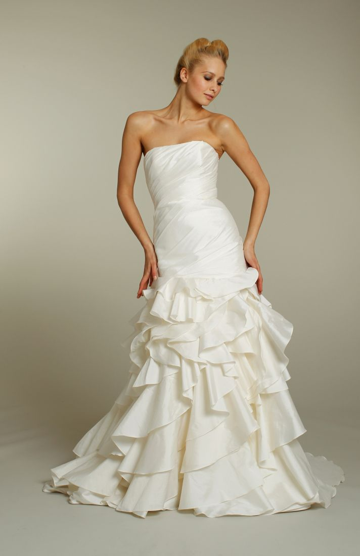 Strapless ivory drop-waist bridal gown with ruffle-embellished skirt