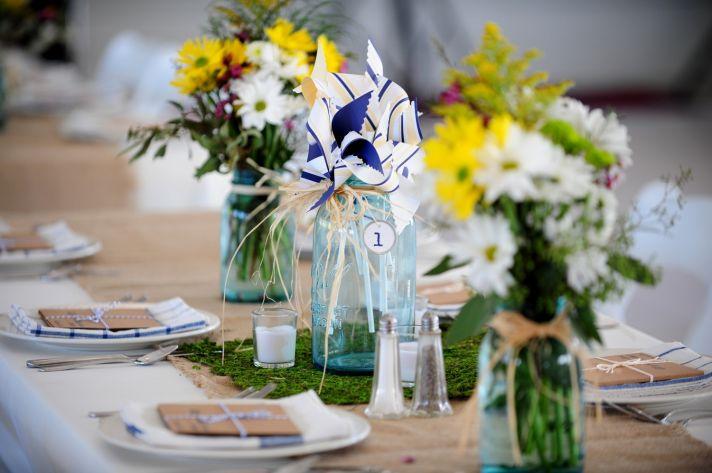 Rustic chic wildflower wedding reception flower centerpieces in glass mason jars