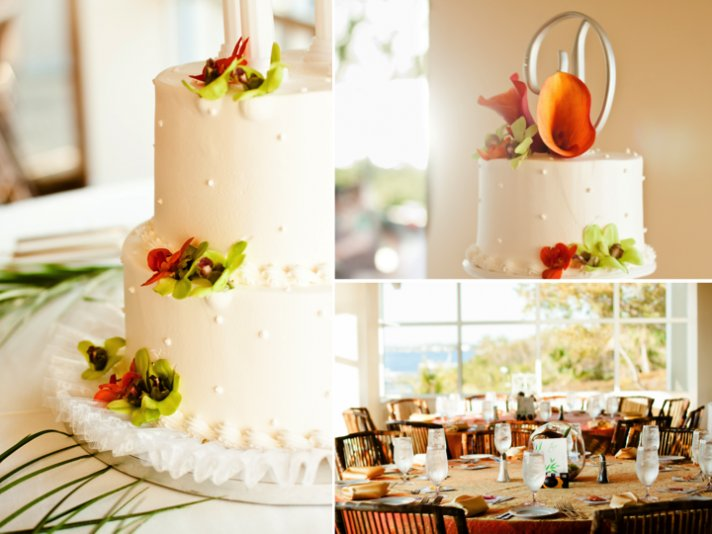 Classic white 3-tier wedding cake with tropical flowers and monogram cake topper