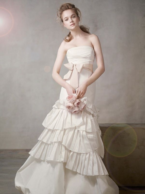 Ivory strapless mermaid wedding dress with blush pink sash by Vera Wang