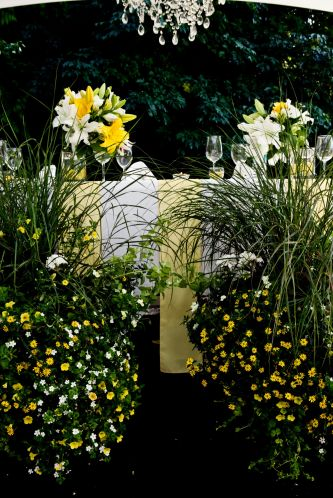 Yellow ivory and green wedding flowers at summer outdoor reception