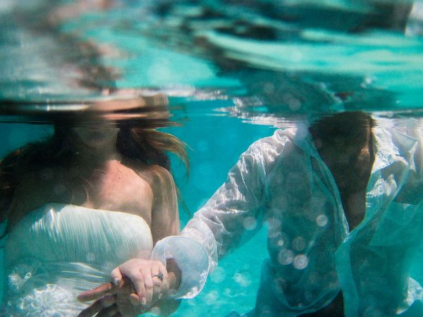 Underwater trash the dress photo session