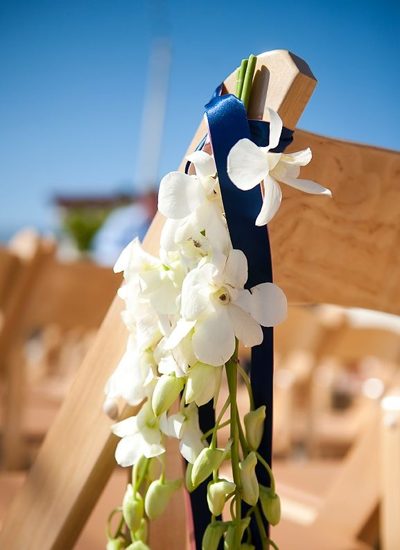 Santa Barbara outdoor wedding ceremony with simple ivory wedding flowers and