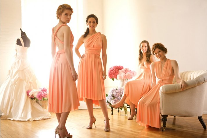 Convertible wrap bridesmaid gowns in soft peach hue