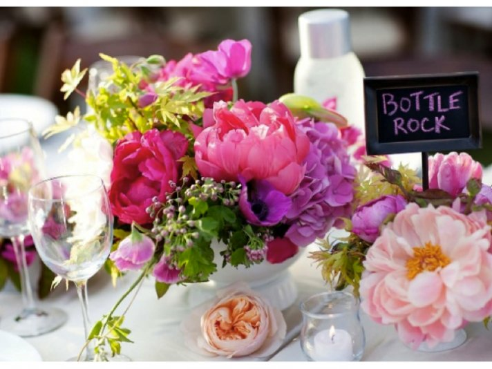 Romantic outdoor wedding reception tablescape with purple and pink wedding flowers