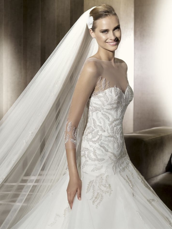 Sheer illusion neckline on 2012 Manuel Mota wedding dress