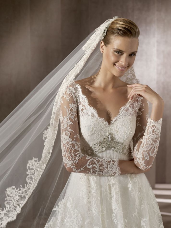 Romantic lace wedding dress with sheer sleeves, traditional bridal veil