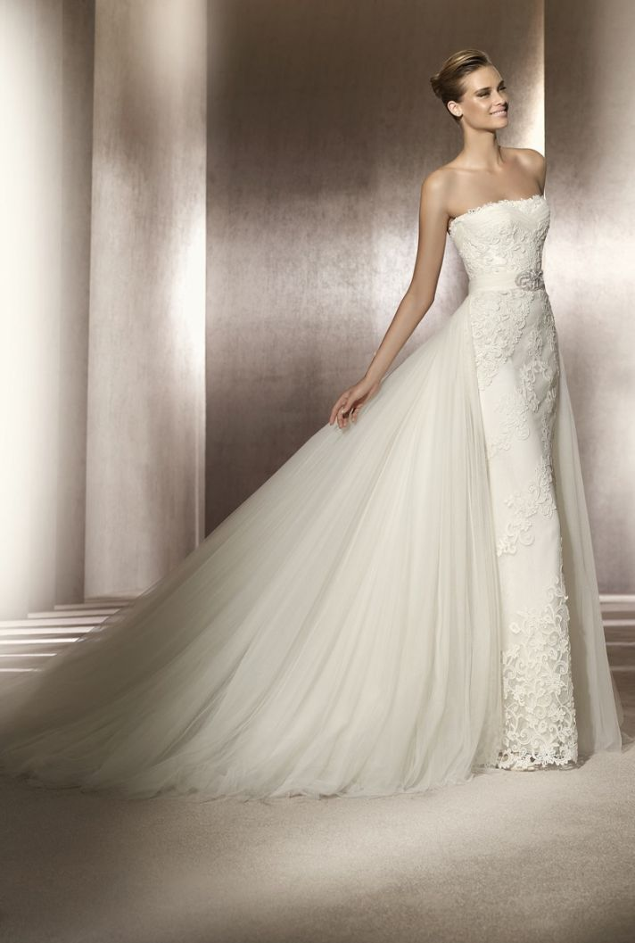 Strapless lace wedding dress with tulle train and bridal belt