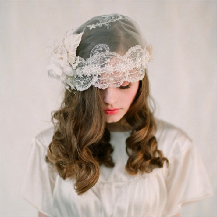 Bohemian bride wears lace bridal cap instead of traditional veil