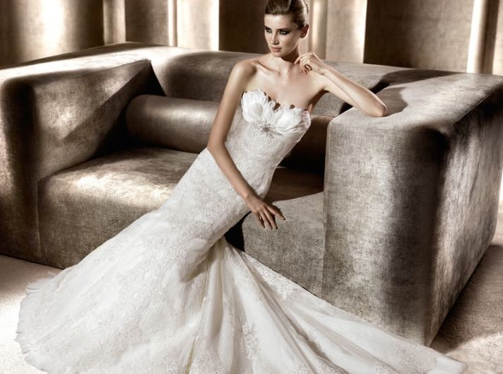 Mermaid wedding dress with feather and crystal-embellished neckline
