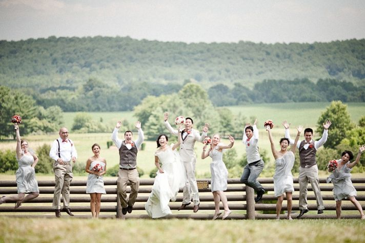Bride groom and wedding party pose outside for wedding photographer
