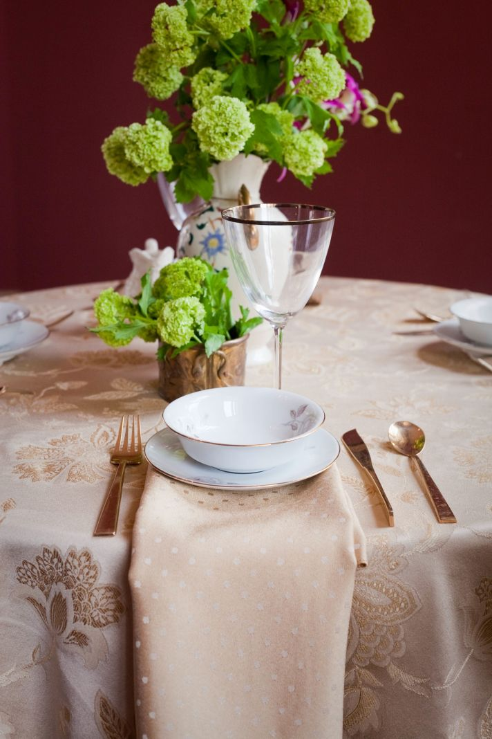 Regal gold wedding reception tablescape with bright wedding flowers