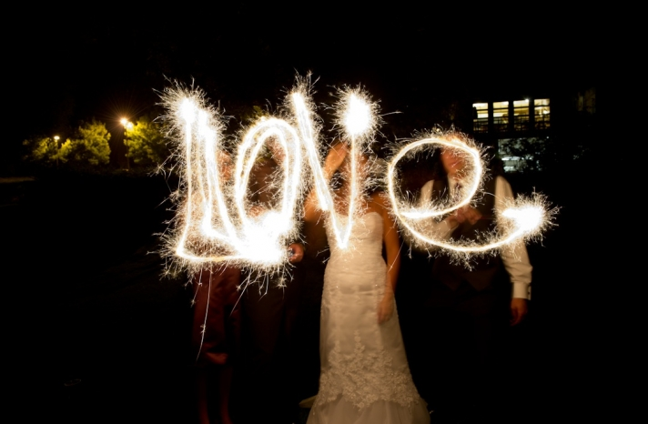 bride-groom-spell-love-with-sparklers-wedding-reception-pictures