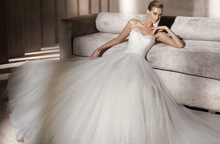 Pronovias featherembellished wedding dress Credit Pronovias