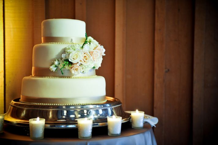 Romantic Wedding Cake with Roses and Ribbon