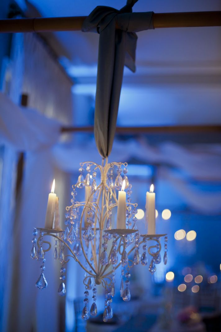 Elegant beach-themed wedding reception decor with chandeliers