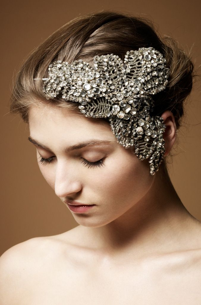 Elegant and dramatic crystal-encrusted bridal fascinator