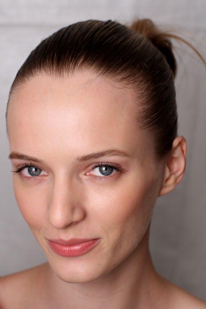 Sleek all-up wedding hairstyle and natural bridal makeup