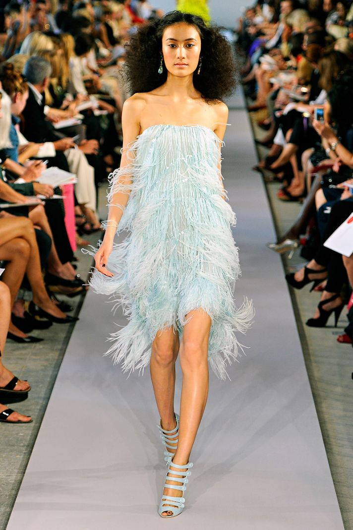 Light blue wedding reception dress adorned with feathers