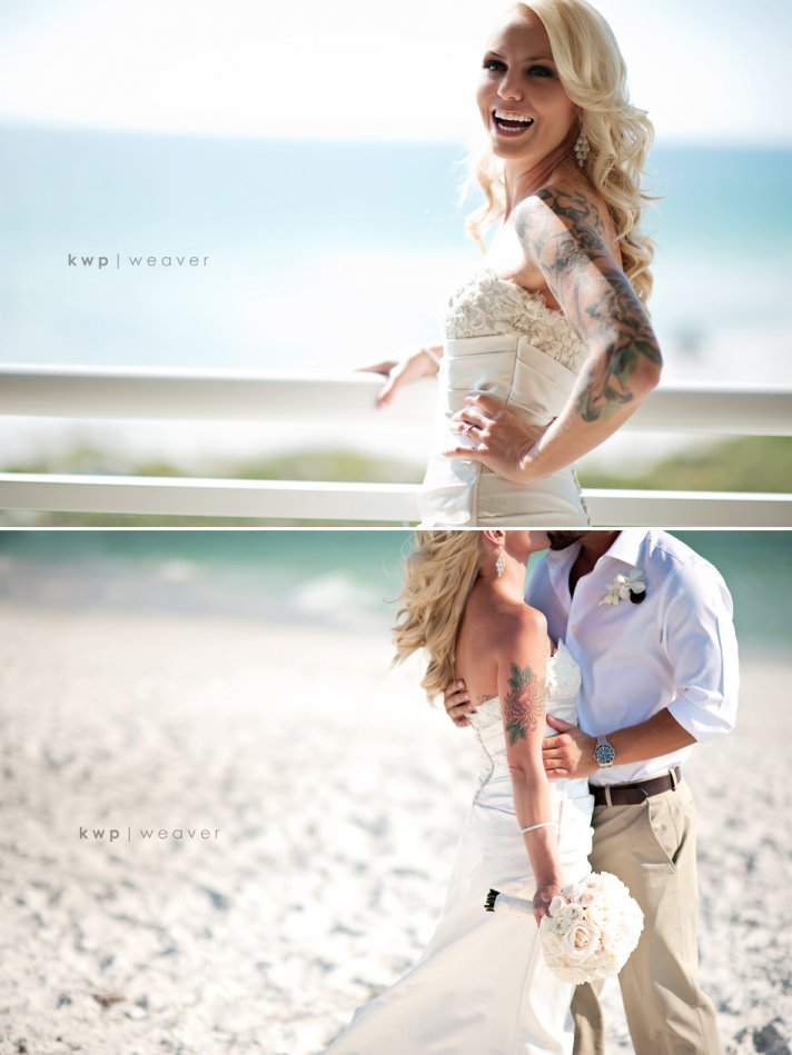 Glamourous tattooed bride kisses groom on the beach