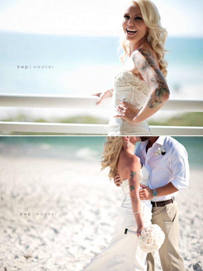 Glamourous tattooed bride kisses groom on the beach