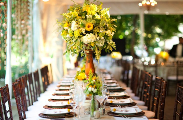 bright yellow wedding flowers reception centerpiece