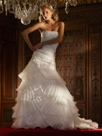 A textured, ruffled, and ruched a-line wedding gown from David's Bridal