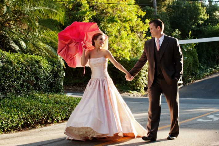 bride wears pink wedding dress strapless ballgown
