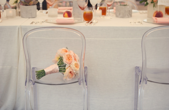 elegant real wedding outdoor reception under tent peach bouquet ghost chairs
