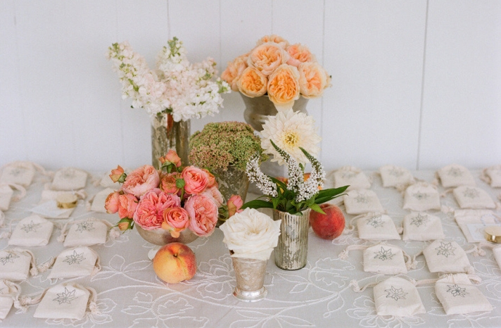 elegant real wedding outdoor reception under tent peach pink wedding flowers