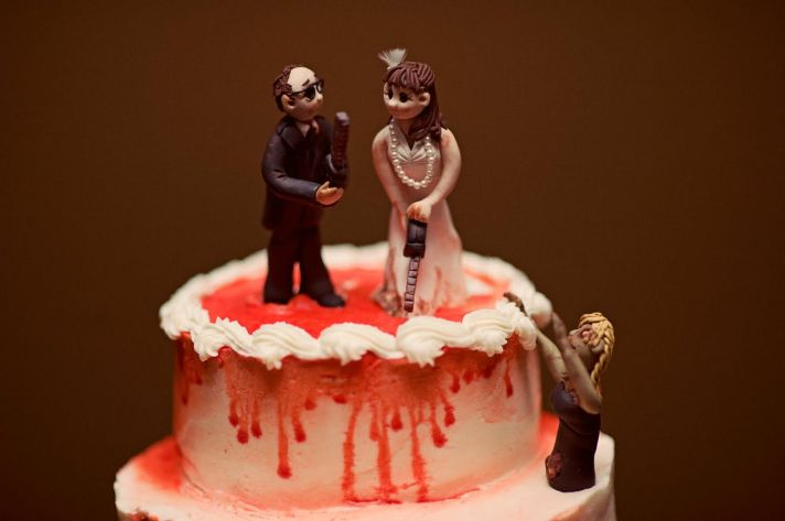 chilling bride and groom wedding cake topper