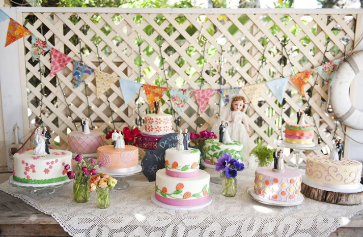 vintage real wedding outdoor venue multiple cakes and toppers