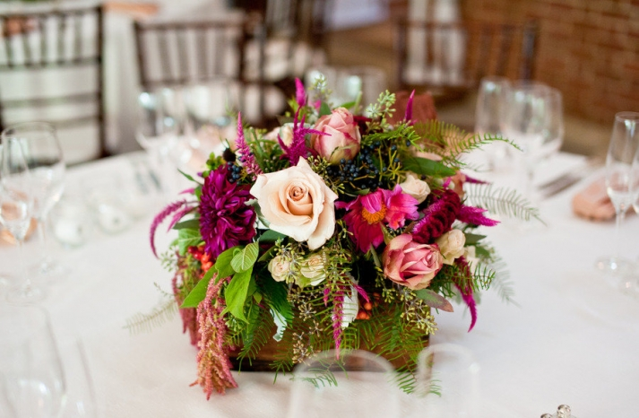 gorgeous wedding centerpiece deep fuschia ivory green