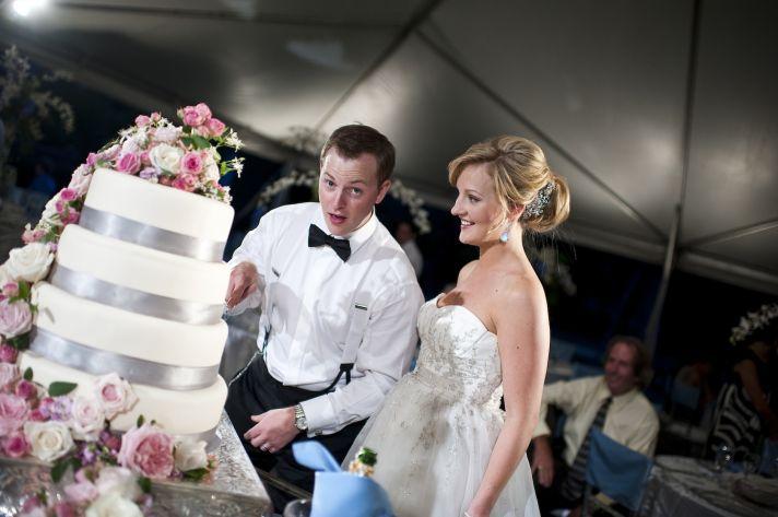 classic real wedding in fall bride groom cut wedding cake