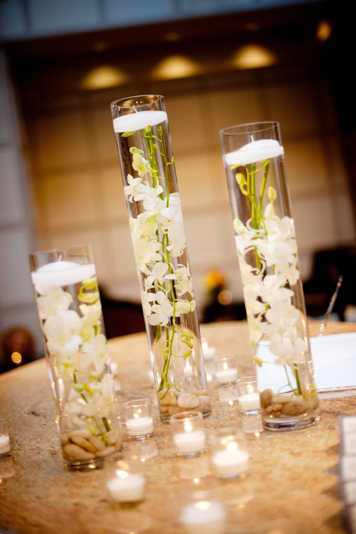 elegant real wedding with simple diy details hurricane vases floating