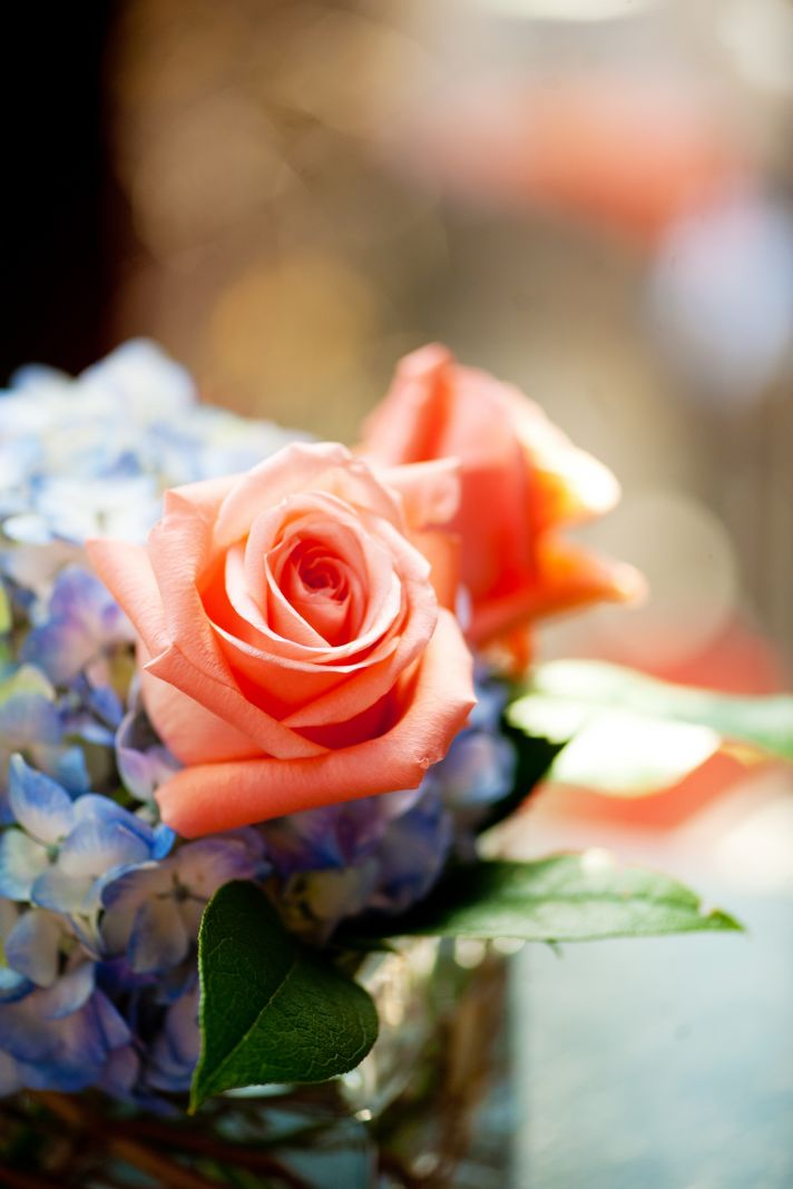 elegant real wedding with simple DIY details centerpieces coral roses